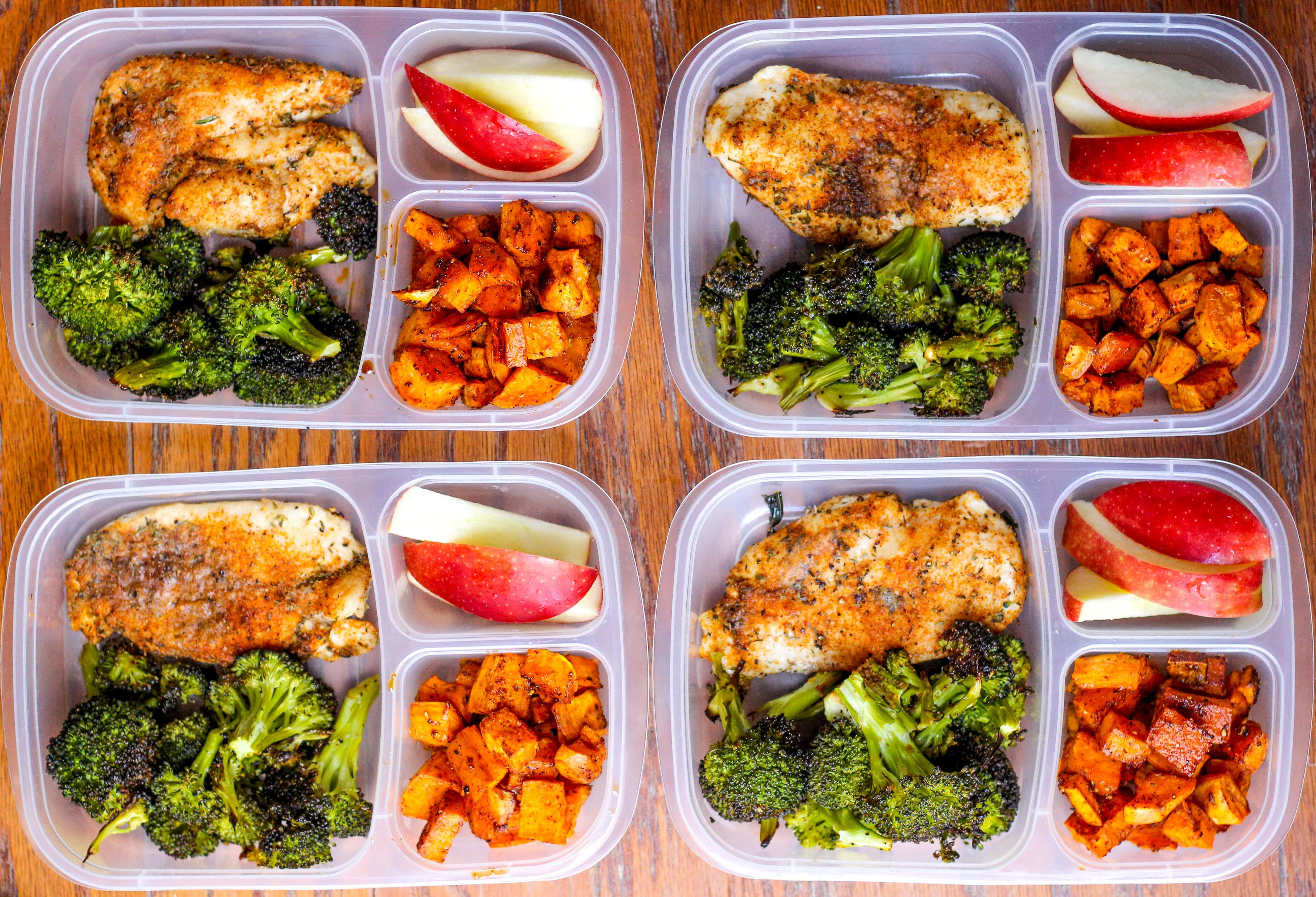 meal prep lunch bowls with spicy chicken, roasted lemon broccoli